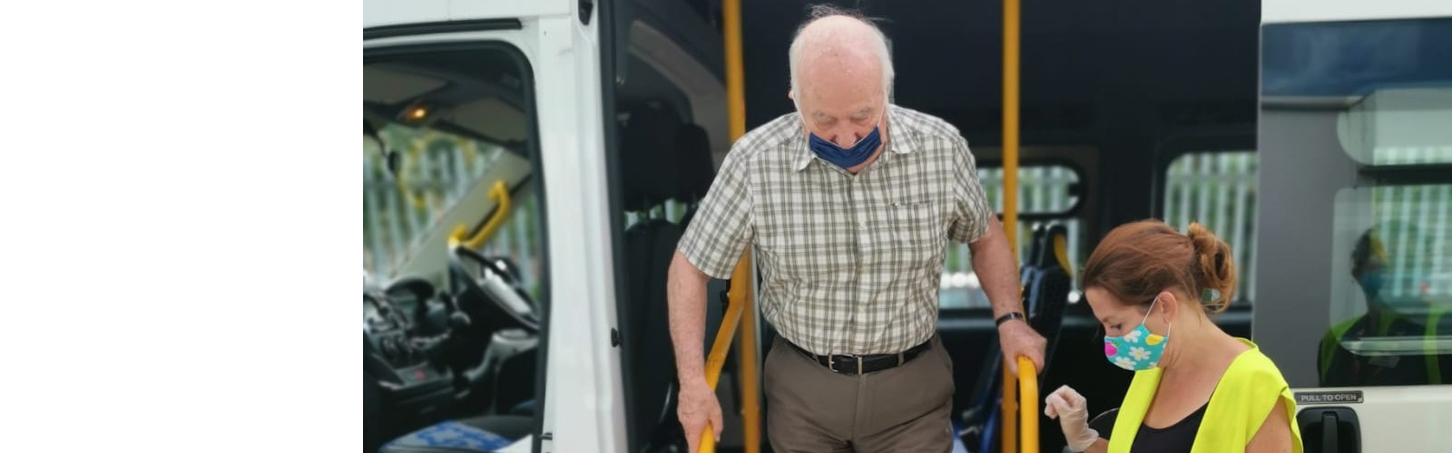An older man steps out of an Age UK Medway vehicle