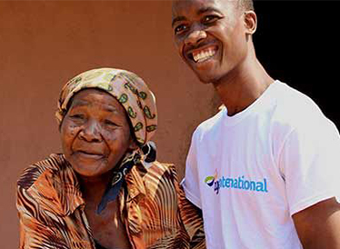 Age International staff working with a lady in Mozambique