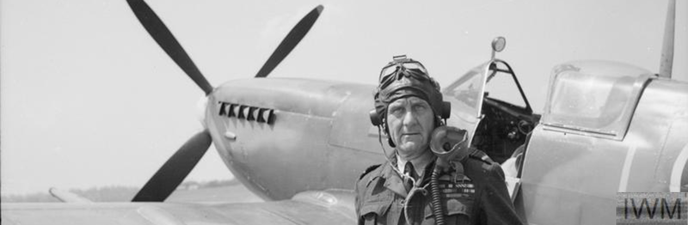 RAF officer standing by his spitfire